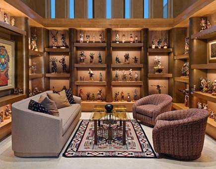 large collections of kachina dolls displayed on shelves by Alpha Design Group via Atticmag