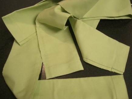 curtain secrets - factory hems removed from the bottom of ready-made green Pottery Barn curtains - Atticmag