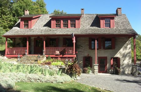 stone houses in Ulster County, NY in the Catskill Mountains - house with dark red trim- Atticmag