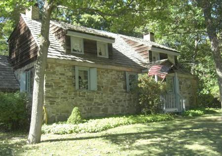 Ulster Country, NY stone houses - stone house with sky-blue porch and trim - Atticmag