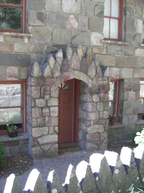 Ulster County, NY stone houses - house with Gothic stone arch around the front door - Atticmag