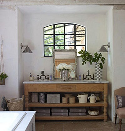 rustic master bath custom sink console with open shelf - House Beautiful via Atticmag