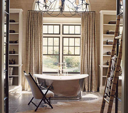 steel windows - luxury master bath with jerusalem gray cobbled flooring and waterworks Candide oval tub by Jeffrey Bilhuber via Atticmag