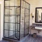steel frame casement window shower by Jeffrey Bilhuber