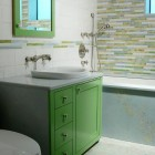 kelly green bathroom - modern bright green bathroom cabinet with marble counter - Complete Tile Collection via Atticmag