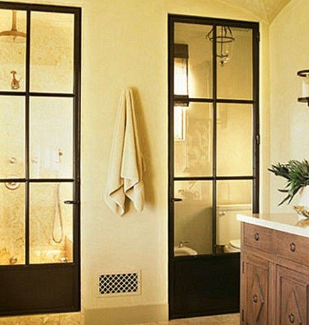 interior window walls - steel french doors used in luxury bathroom by Madeline Stuart via Atticmag