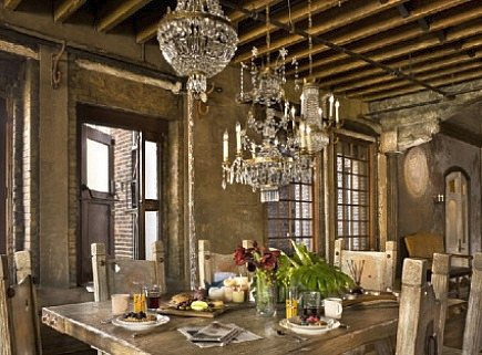 old world dining room with clustering of multiple crystal chandeliers - AD via Atticmag