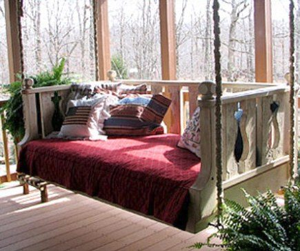 custom hanging painted wooden swinging porch bed made from vintage architecture porch railings - Seibels via Atticmag