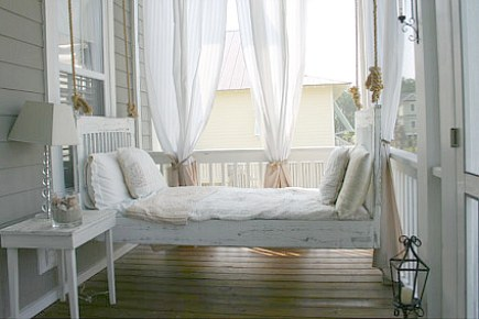 custom hanging painted wooden swinging porch bed made from wood - Extraordinary Coastal Living via Atticmag