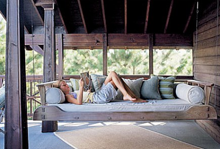 custom hanging wooden swinging porch bed with mortise and tendon joinery - Coastal Living via Atticmag