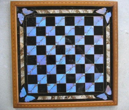 butterflies - vintage chess or checker board with inlaid wood made with butterfly wings -via Atticmag