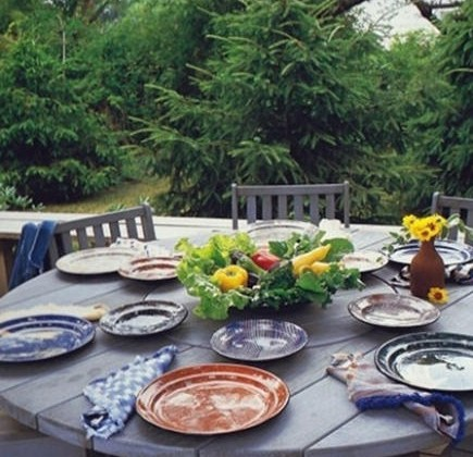 mixed pattern - outdoor setting of mixed pottery tableware by cera mix studios via Atticmag