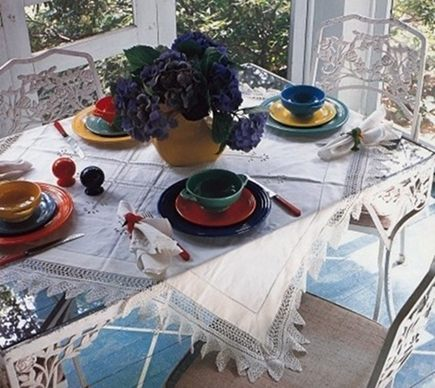 mixed pattern - screen porch table set with colorful Homer Laughlin fiestaware via Atticmag