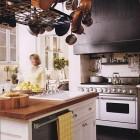 black and white kitchen with custom black range hood - BH&G via Atticmag