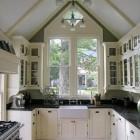 black and white kitchen in a Victorian cottage kitchen - garden web via Atticmag