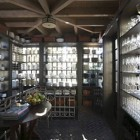 china room - windowed room with shelves for china and glassware storage - Dungan Nequette via Atticmag