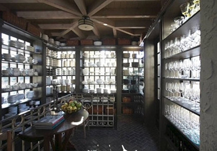 china room - a windowed room with shelves for china and glassware storage in the Salie House - Dungan Nequette via Atticmag