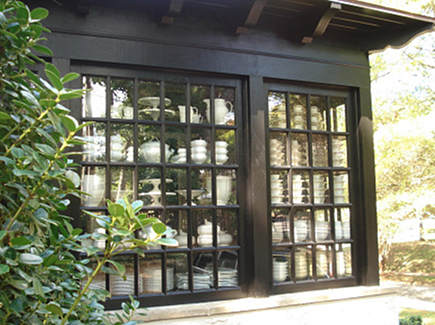 china room - exterior view of china and glassware storage seen through the windows - Dungan Nequette via Atticmag