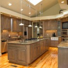 driftwood gray traditional kitchen with black-glazed cabinets - adelphi kitchens via Atticmag