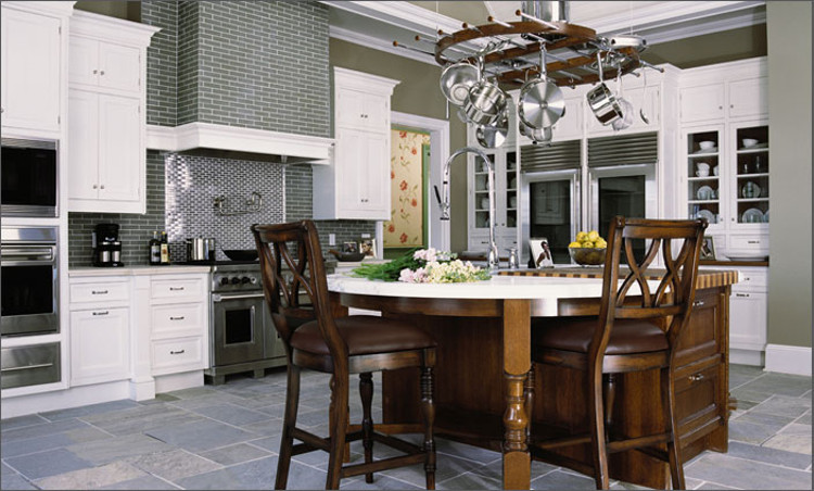 family kitchen with gray and steel tile and round eating peninsula - Christopher Peacock via Atticmag
