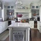 silver gray wall kitchen - white kitchen with gray subway tile and Carrara marble counter - House & Garden via Atticmag