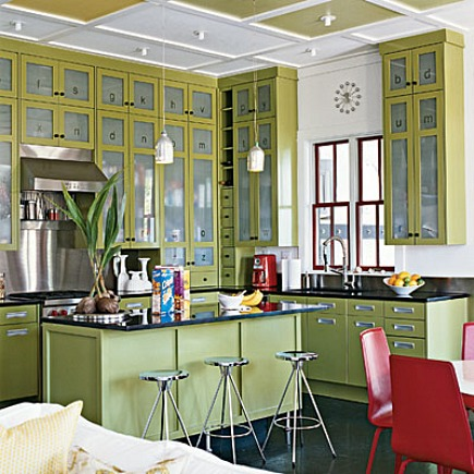 modern green kitchen with etched glass cabinet doors and red accents