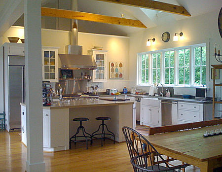 white kitchen with barn ceiling and concrete counters - Atticmag