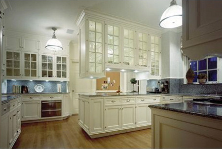 white kitchen - with double sided glass upper cabinet - Ferguson & Shamamian via Atticmag