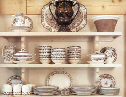 warm white kitchens - brown and white transferware collection on open shelving - Modern Country via Atticmag