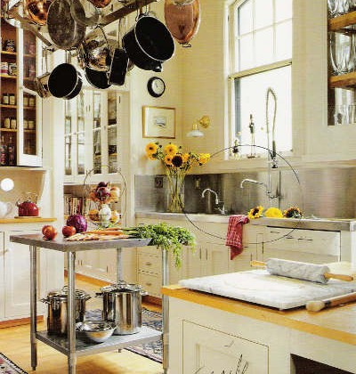 stainless backsplash - White kitchen with stainless backsplash and work table and sink with prerinse faucet. - via Atticmag