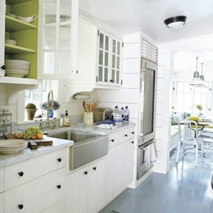 white kitchen trend - white kitchen with green painted inside cabinets for color - House Beautiful via Atticmag