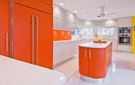 white kitchen trend - color block kitchen with white and orange cabinets - hamptondesign via Atticmag