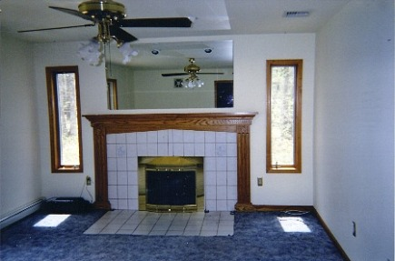 fireplace renovation - existing fireplace with oak mantel and floor tile - Atticmag