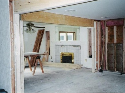 fireplace renovation - the old fireplace partially stripped of the mantel - Atticmag