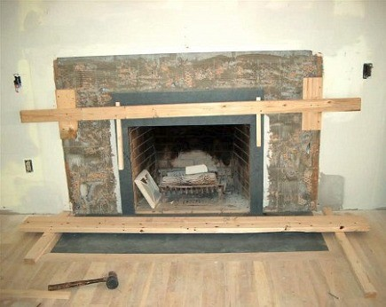 fireplace renovation - the mantel surround with pietra cardosa stone replacing the ugly tile - Atticmag