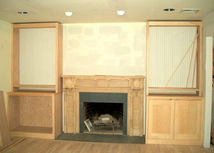 fireplace renovation - cabinets and bookshelves flanking the new mantel framed and in progress - Atticmag