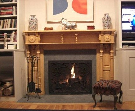 fireplace renovation - oiled fireplace mantel installed and functioning - Atticmag