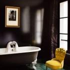 bathroom with painted black walls and black footed bathtub - WOI via Atticmag