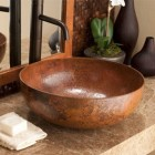 Native Trails copper vessel sink on marble counter with oil-rubbed bronze faucet - via Atticmag