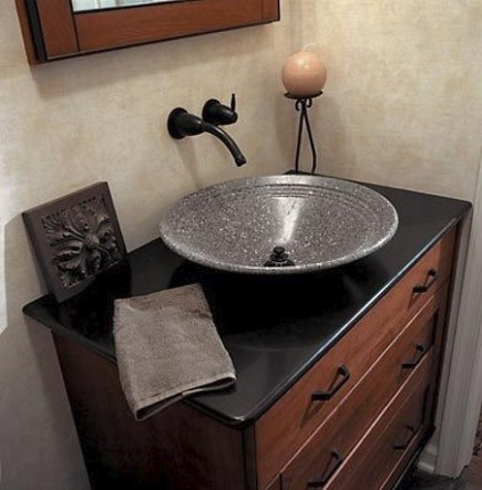 Gray stone vessel sink in mission style powder room - via Atticmag
