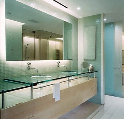 floating vanity with - glass countertops, integrated glass sinks and mosaic tile walls - Susan Fredman via Atticmag