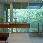 modern indoor-outdoor bathroom with outside glass wall and glass shower - alterstudio via atticmag