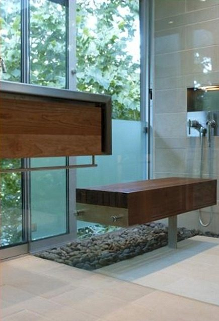 indoor-outdoor bathroom with custom wooden bench inside glass enclosed shower with etched privacy section of the glass wall - alterstudio via atticmag