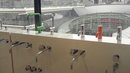 juicy color Vola brand bathroom faucets display at Hastings Tile and Bath in Manhattan showroom - Atticmag