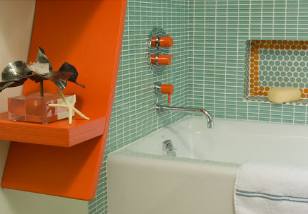 tub detail of juicy color green and orange bath with Vola color plumbing fixtures - Mary Anne Smiley via Atticmag