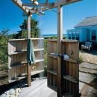 outdoor shower with rain head shower - Hutker Architect via Atticmag