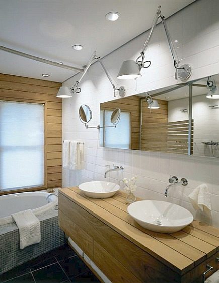 wood plank master bath - horizontal wooden planked walls and a double plank vanity in beach house bathroom - Hutker Architects via Atticmag