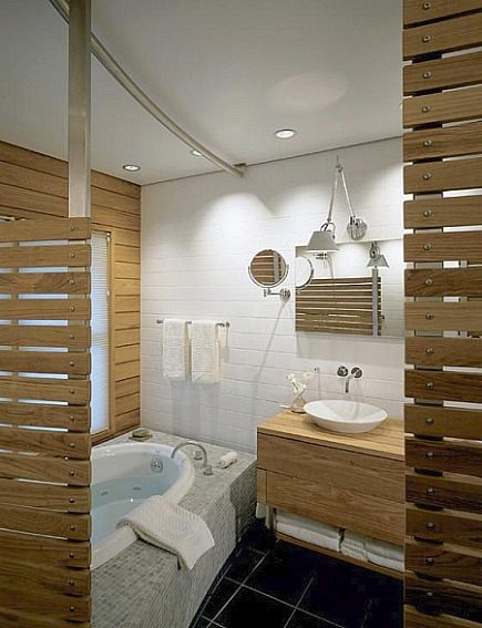 wood plank master bath - modern bathroom with horizontal wooden plank walls and double sink vanity against a white tile wall - Hutker Architects via Atticmag