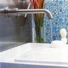 bathroom sinks - Danze Parma wall mounted faucet with a Kohler Purist flat overflow sink - Met Home via Atticmag