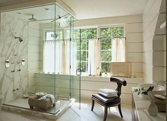 calacatta marble shower in a white mater bathroom by Jeffrey Bilhuber - via Atticmag